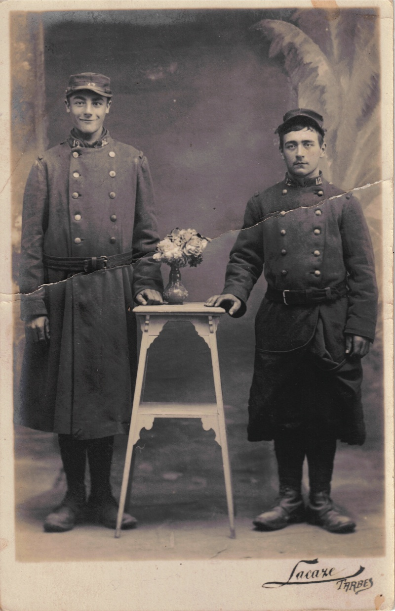 Two French Soldiers Alongside Bouquet. Estimated Date: 1914/15